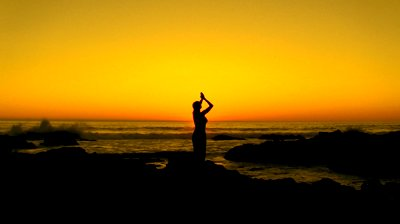 stock-footage-yoga-by-the-ocean-in-silhouette